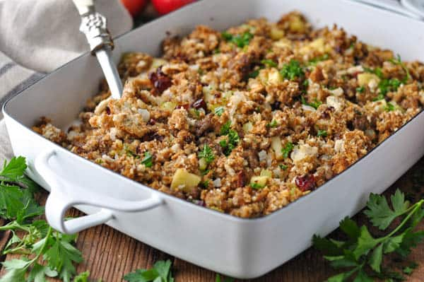 Horizontal shot of Thanksgiving sausage stuffing in a white dish