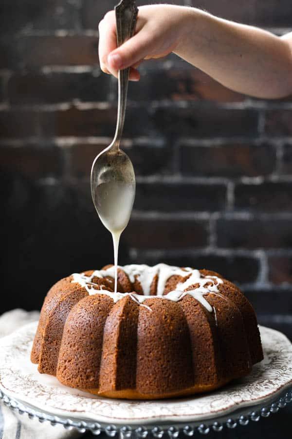 Drizzling glaze on a cinnamon coffee cake