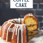 Lifting a slice of sour cream coffee cake with a text title box at the top