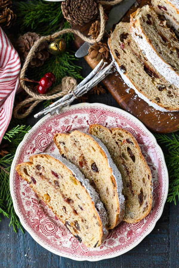 Close overhead image of three slices of German stollen bread on a red and white plate
