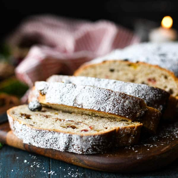 Square image of close shot of German stollen bread on a cutting board