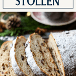 Sliced loaf of Christmas stollen on a cutting board with text title box at the top