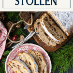 Overhead shot of Christmas stollen on a table with greens and a text box at the top