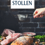 Sprinkling powdered sugar on stollen bread with text title box at the top