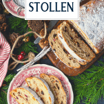 Overhead image of stollen served on a red and white plate with text title box at the top