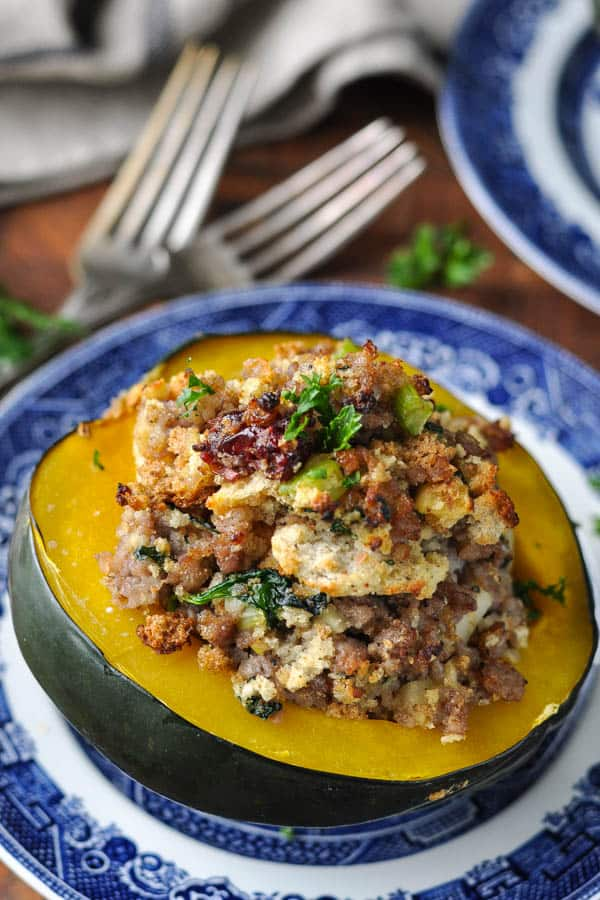 Close up shot of baked stuffed acorn squash on a plate
