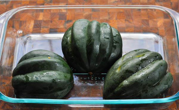 Acorn squash in a glass dish for cooking
