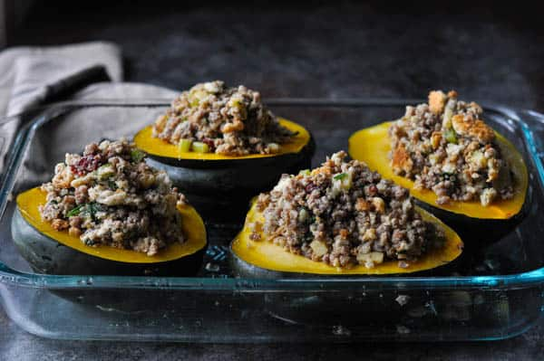 Step by step process shot of how to make stuffed acorn squash