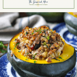 Sausage and Apple Stuffed Acorn Squash on a plate with a text title box at the top