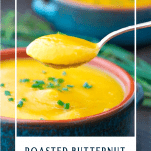 Spoon lifting a bite of roasted butternut squash soup with text overlay
