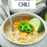 Close up side shot of a bowl of easy white bean chicken chili with title overlay at top