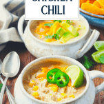 Front shot of two bowls of white chicken chili and a text title box at top
