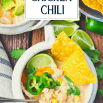 Overhead shot of a bowl of white bean chicken chili with a text title box at the top