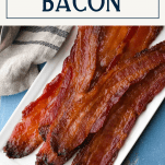 Overhead image of pig candy bacon on a white rectangular tray with text title box at top