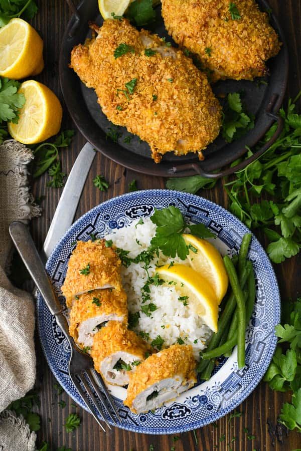 Authentic chicken kiev recipe served on a plate with rice and green beans