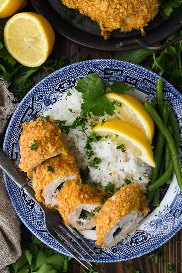 Chicken Kiev recipe served on a plate with rice and green beans