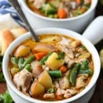 Front shot of homemade chicken stew in a white bowl