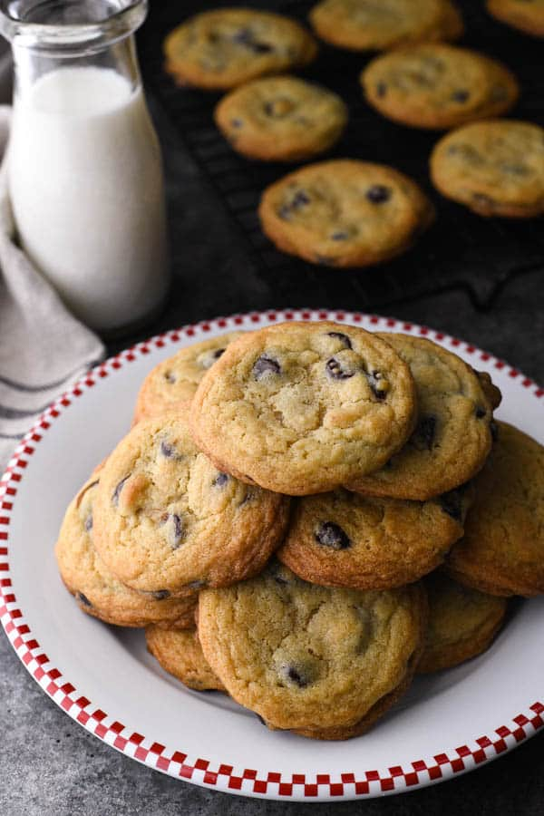 Overhead shot of a plate full of soft and chewy chocolate chip cookies