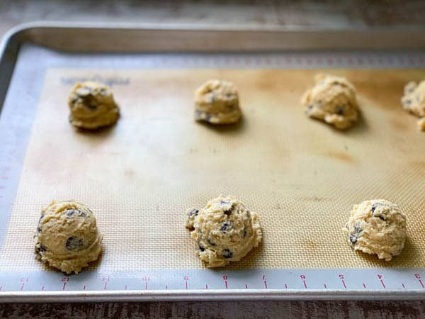 Process shot showing how to make chocolate chip cookies