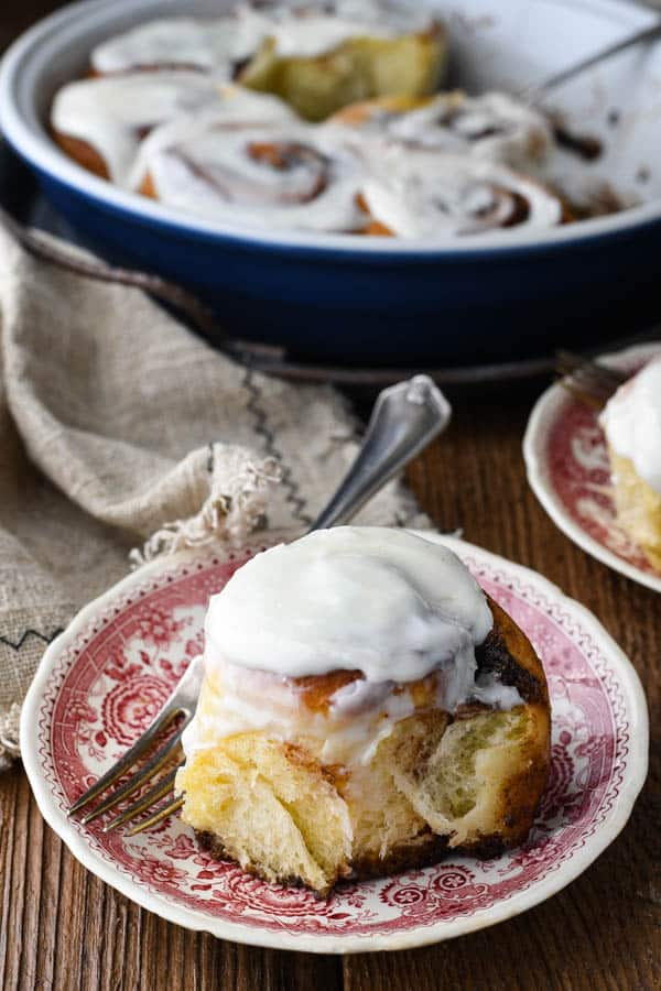 The best cinnamon roll recipe served on a red and white plate