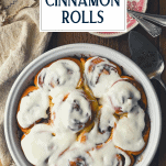Overhead image of homemade cinnamon rolls in a round pan with text title overlay