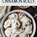 Overhead shot of cinnamon rolls with text title box at top