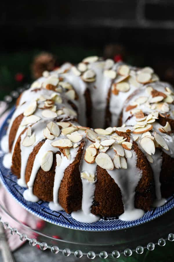 Sour cream coffee cake with icing and almonds on top