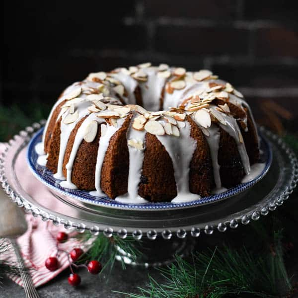 Square image of cranberry coffee cake for Christmas breakfast on a glass cake stand