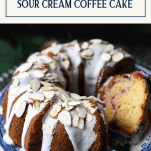 Front shot of a plate of sour cream coffee cake with text title box at top