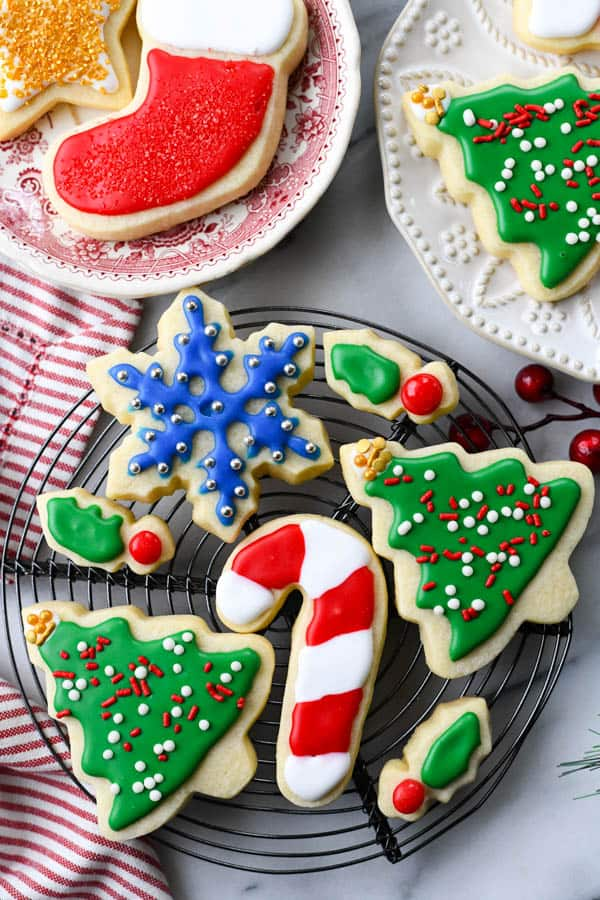Overhead image of cut out sugar cookies on a wire cooling rack