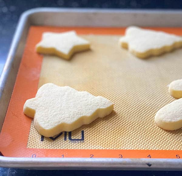 Baked cut out sugar cookies on a baking sheet