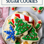Overhead shot of white plate of the best sugar cookie recipe with text title overlay