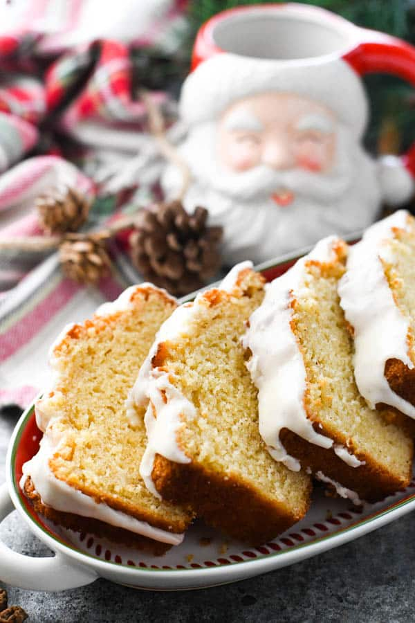 Christmas eggnog bread sliced and served on a holiday platter