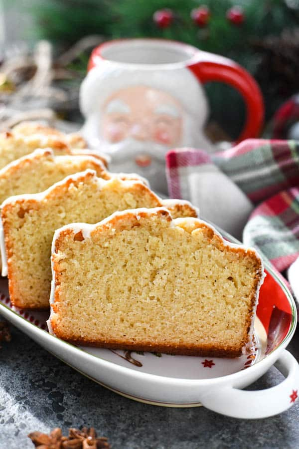 Front shot of moist eggnog quick bread served on a holiday platter