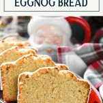 Front shot of Christmas eggnog bread on a platter with title box at top