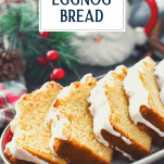 Text title overlay on an image of sliced glazed eggnog bread