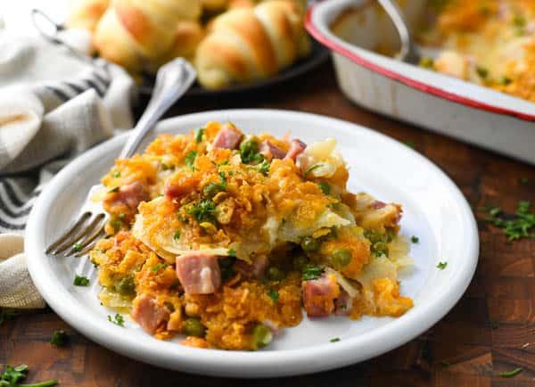 Horizontal shot of a plate of leftover ham and potato casserole