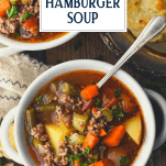 Overhead image of two bowls of hamburger soup recipe with text title overlay