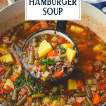 Ladle serving old fashioned hamburger soup with text title overlay
