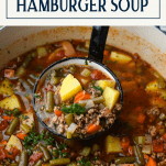 Close up shot of a ladle full of hamburger vegetable soup with a text title box at the top