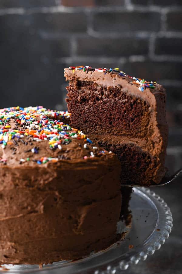 Serving a slice of homemade chocolate cake on a spatula