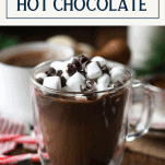 Front shot of a mug of homemade hot chocolate recipe with text title box at top