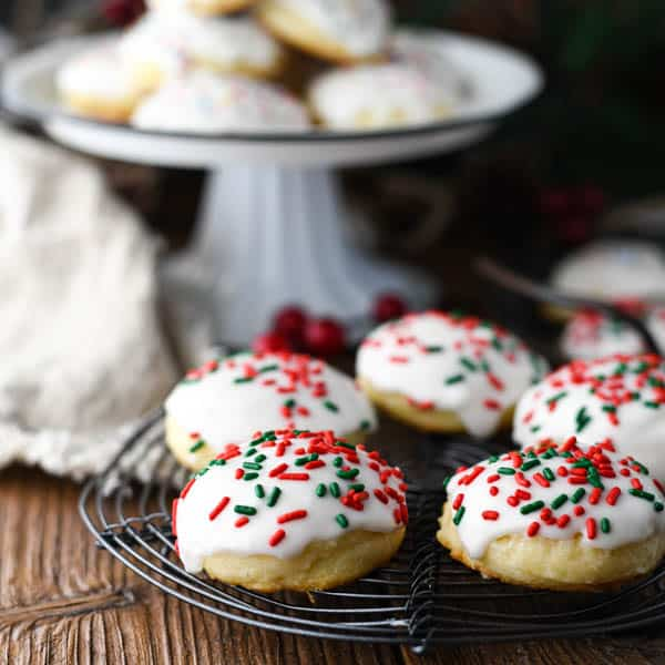 Square image of Italian Christmas Ricotta Cookies on a wire rack