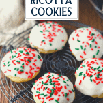 Ricotta cookies with Christmas sprinkles on a wire rack with text title overlay