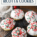 Tray of Italian ricotta cookies on a wire rack with text title at the top