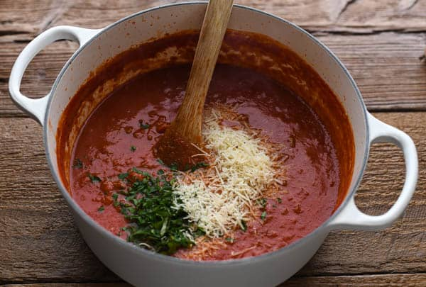 Italian sausage pasta sauce in a white dutch oven