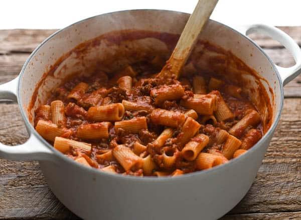 Process shot showing how to make Italian Sausage Pasta