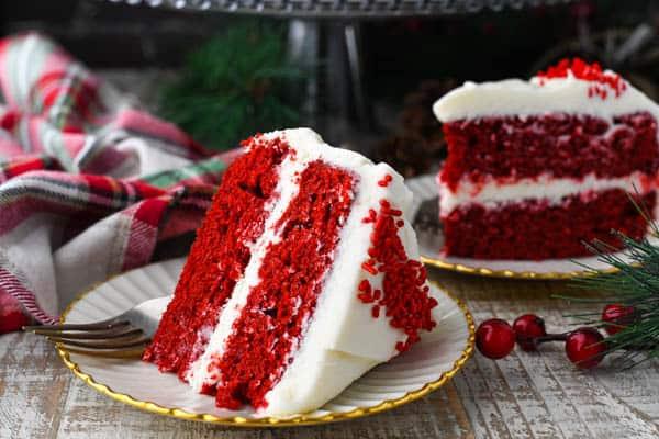 Horizontal shot of a slice of red velvet cake on a white table