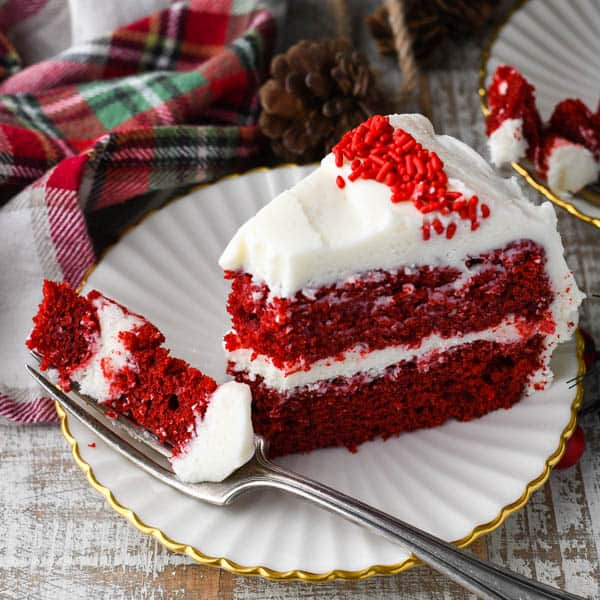 Horizontal shot of red velvet cake slice with a bite on a fork