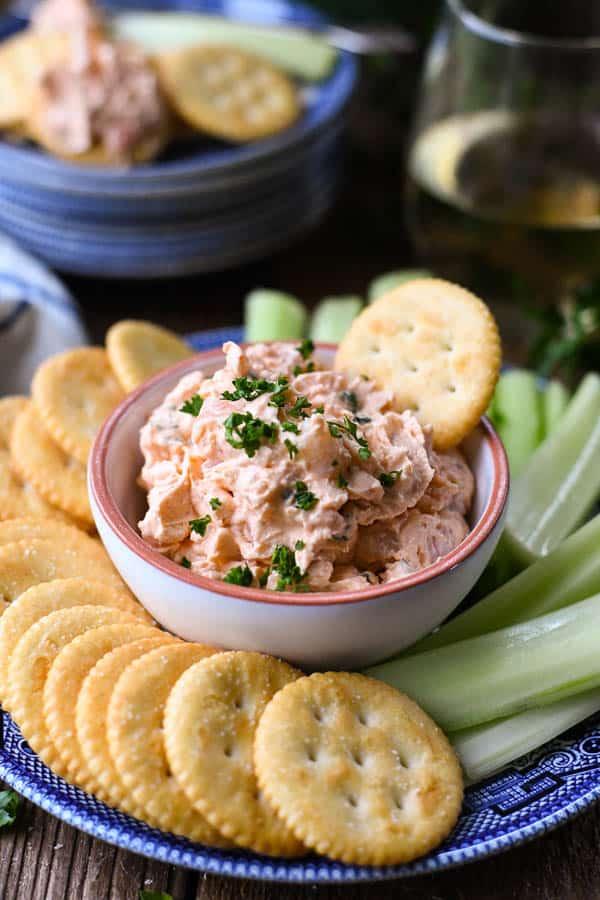 Side shot of a serving platter with shrimp dip appetizer